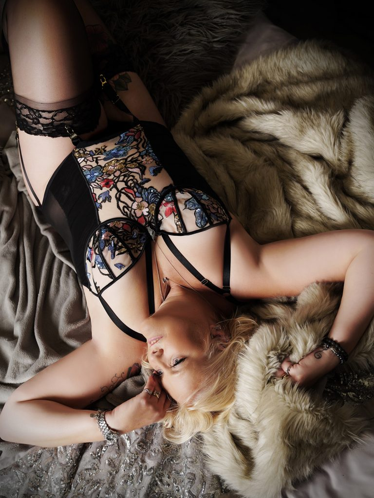 Woman wearing a basque during her lingerie shoot