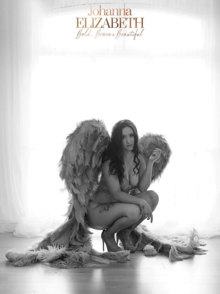 Woman wearing large angel wings
