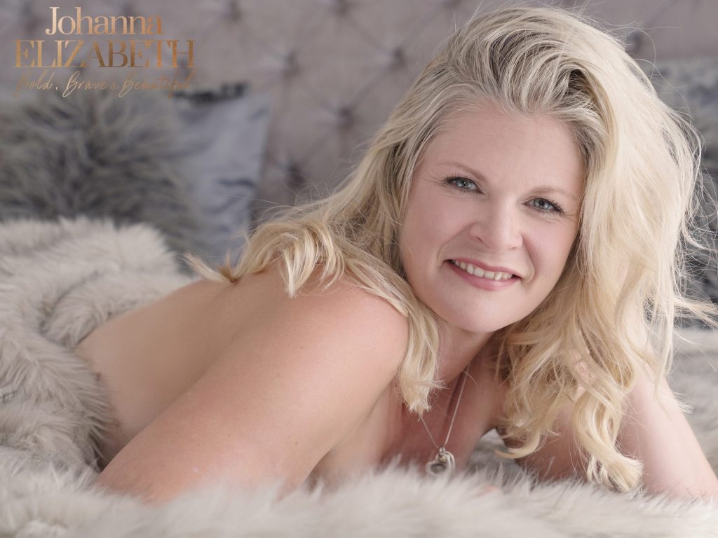 Blonde smiling woman during boudoir photoshoot
