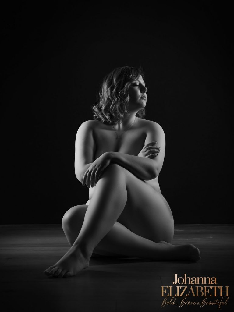 Woman during a nude boudoir photoshoot