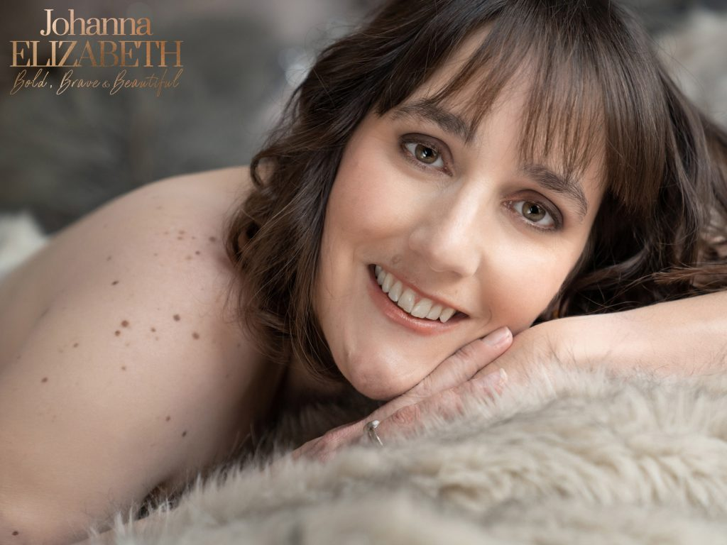 Smiling lady with brown hair during boudoir shoot