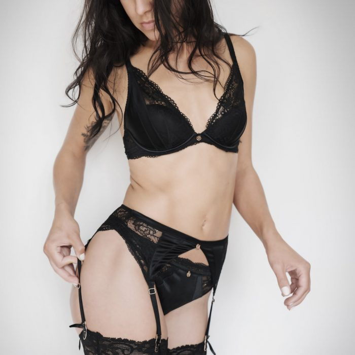 Woman wearing bra and pants during lingerie photoshoot