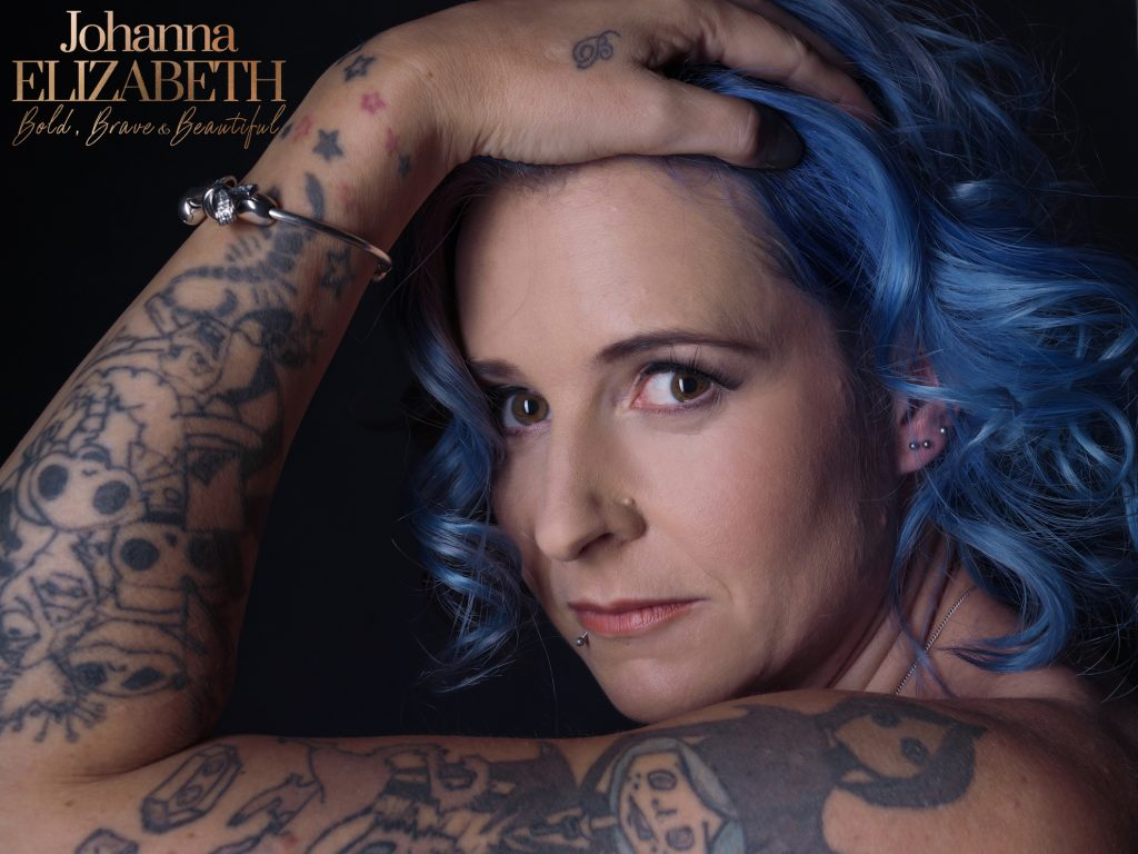 Attractive woman with blue hair and tattoos