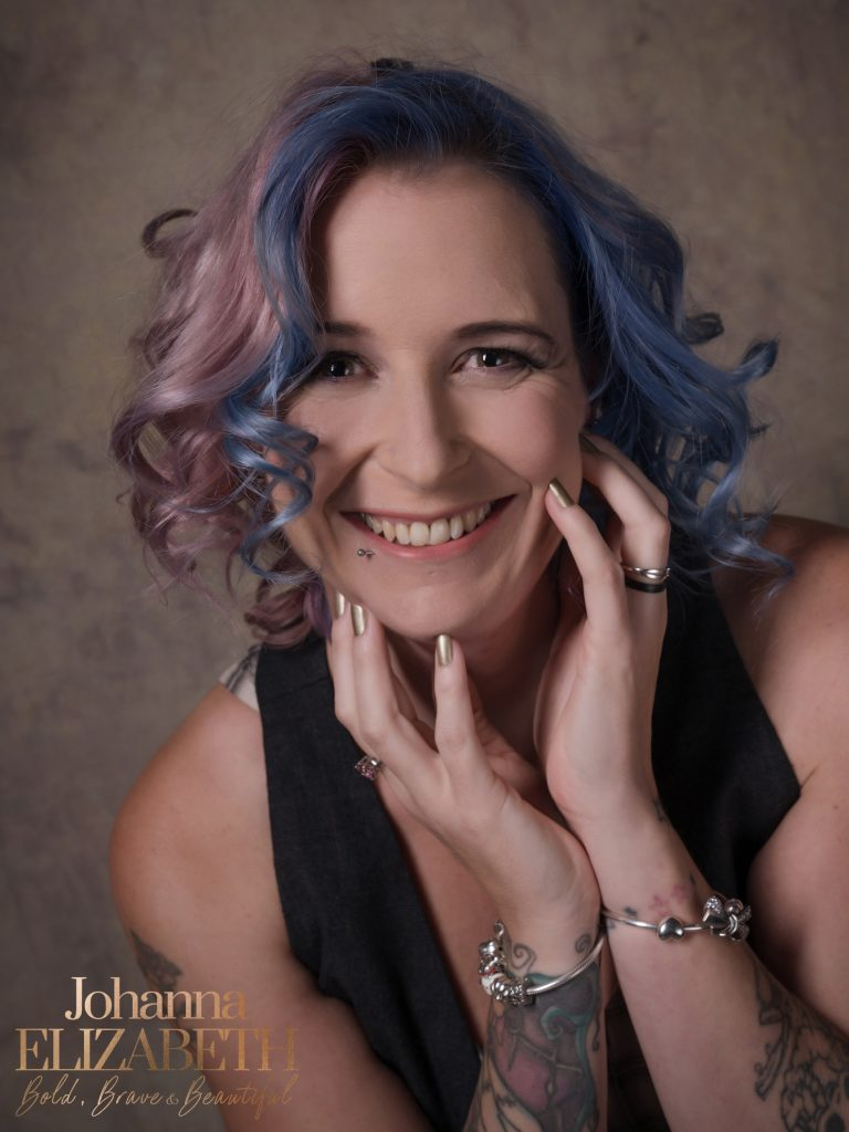 Smiling woman with blue and pink tinted hair