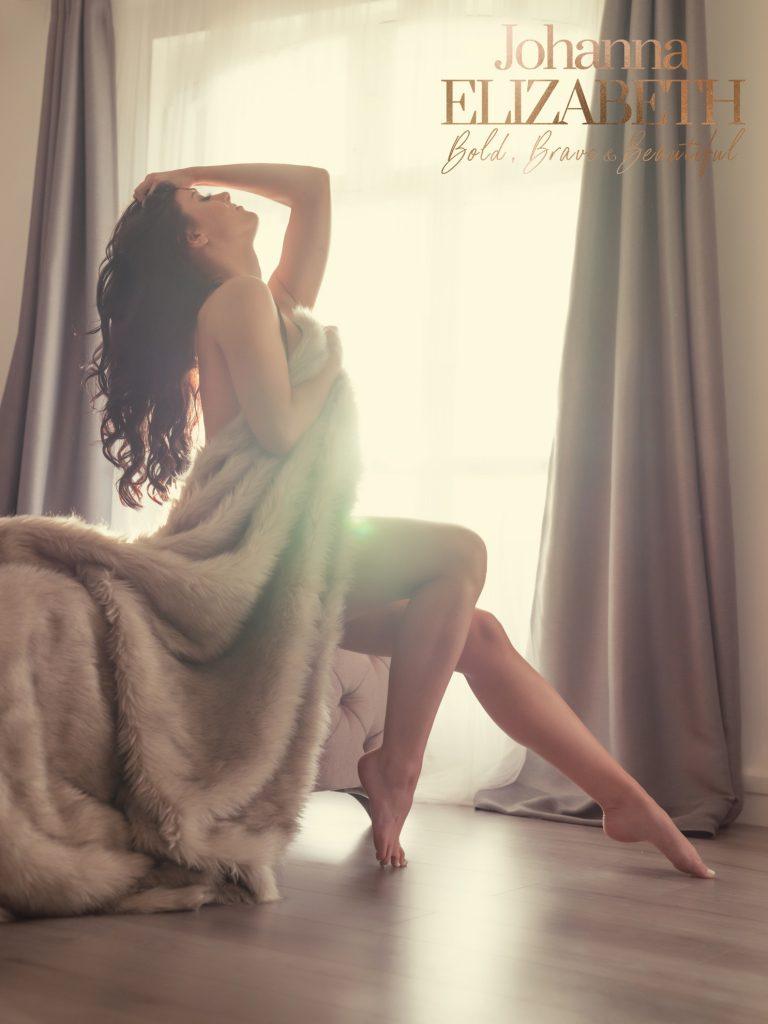 Woman in boudoir photography studio