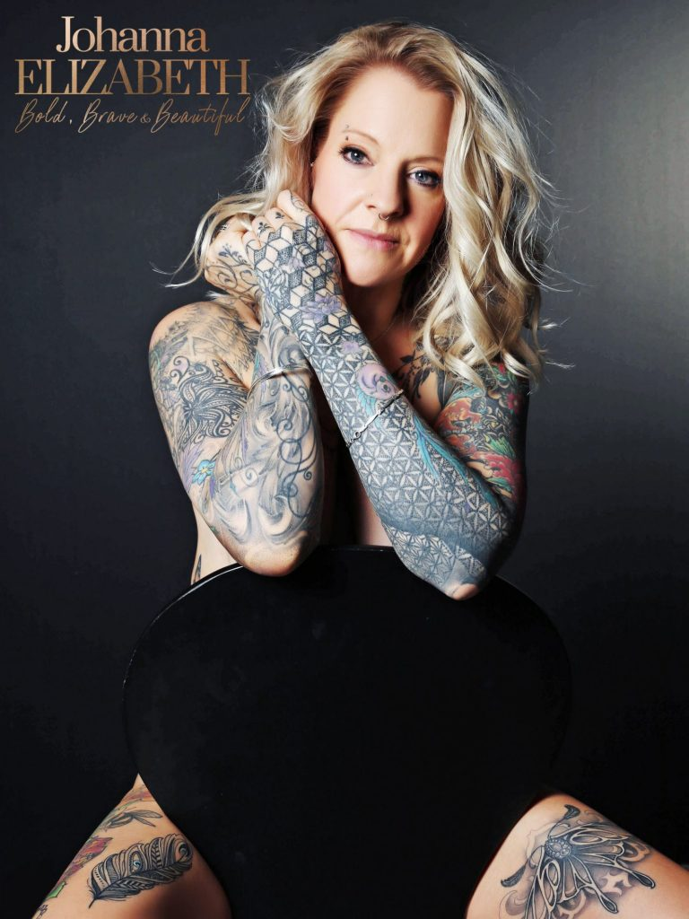 Blonde lady with tattoos on her arms