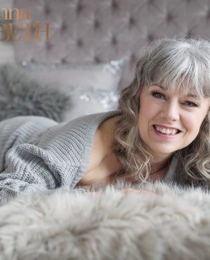 Confident, smiling lady during a boudoir photoshoot